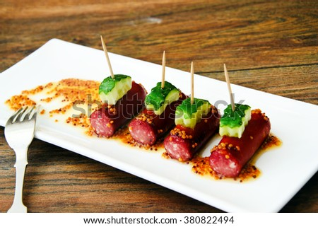 Cocktail Sausage and Cucumber on Plate. Studio Photo - stock photo