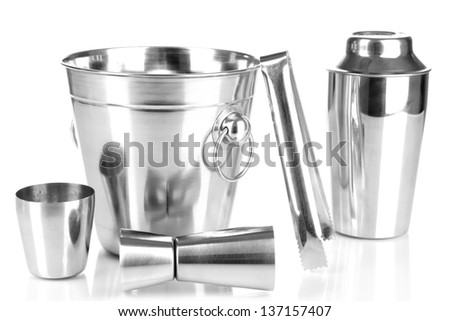 Cocktail shaker and metal ice bucket isolated on white