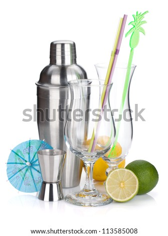 Cocktail shaker, glasses, utensils and citruses. Isolated on white background - stock photo