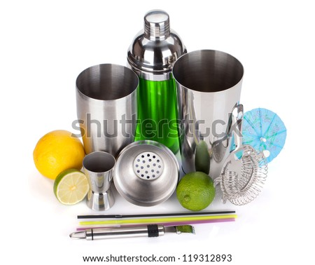 Cocktail shaker, strainer, measuring cup, drinking straws and citruses. Isolated on white background