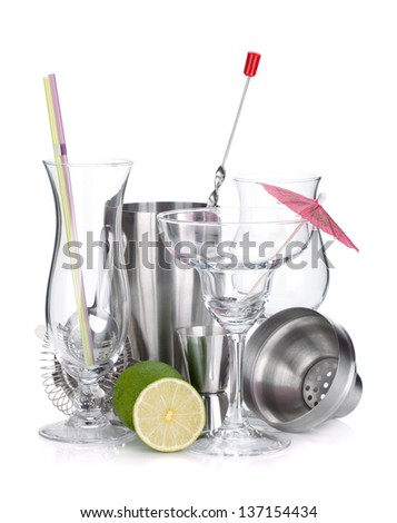 Cocktail shakers, glasses, utensils and lime. Isolated on white background - stock photo