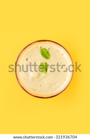 Cocktail Smoothie on Yellow Background, Top View - stock photo