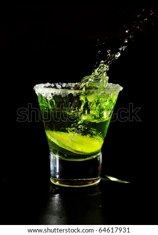 cocktail splash in glass isolated on black - stock photo