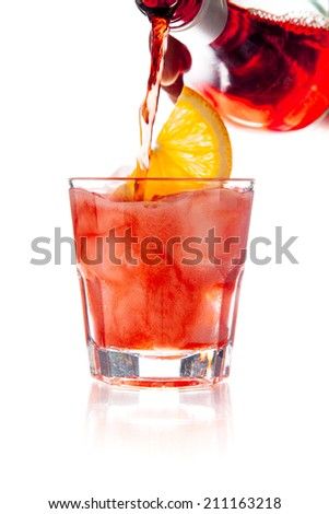 Cocktail to glass on white background - stock photo