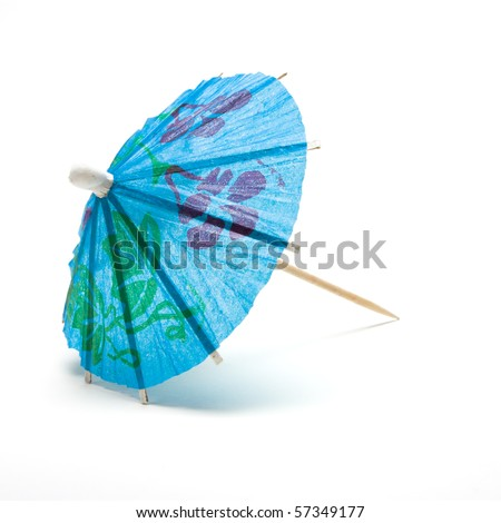 Cocktail Umbrella from low perspective isolated against white background. - stock photo