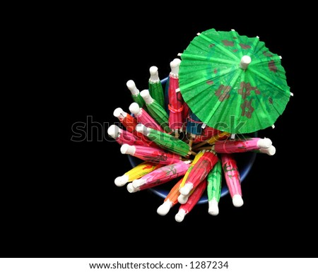 Cocktail umbrellas (isolated against black)