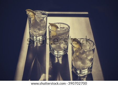 Cocktail vodka or gin with ice vintage.vodka in a glass with ice, lime, a cocktail bar, alcohol, alcoholic beverage. Closeup - stock photo