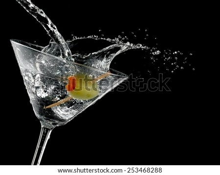 Cocktail with a green olive splash, close up - stock photo