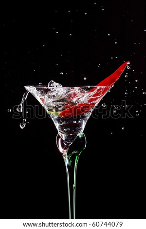 Cocktail with chilli pepper isolated on black - stock photo