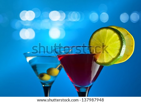 cocktail with citrus on a blue background - stock photo