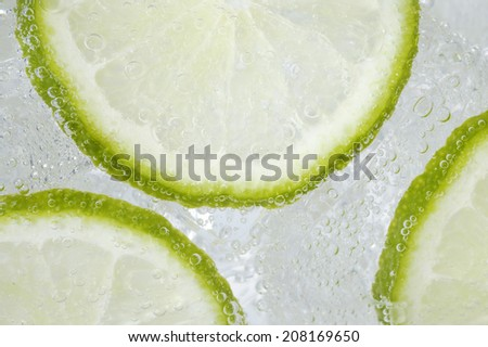 Cocktail with ice and lime - stock photo