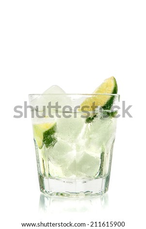 Cocktail with ice and lime slice - stock photo