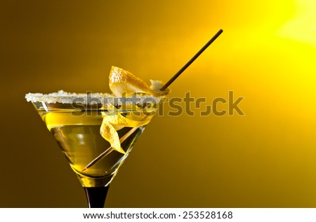 cocktail with lemon , focus on a foreground - stock photo