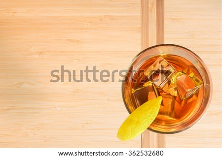 Cocktail with Lemon on bamboo board