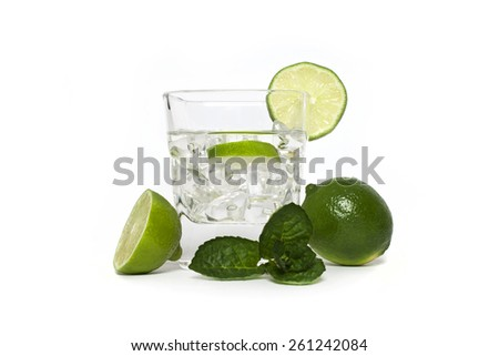 Cocktail with lime and ice, Cocktail with lime - stock photo