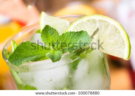 cocktail with lime and mint - stock photo
