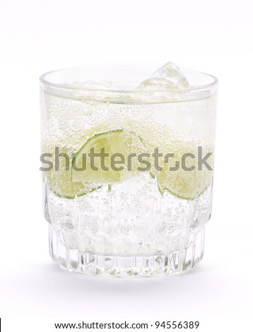 Cocktail with lime and mint. - stock photo