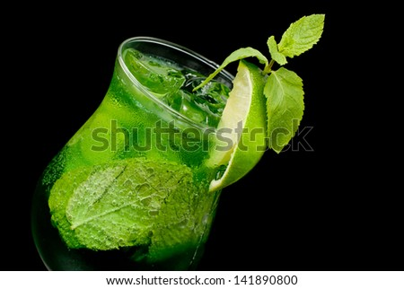 cocktail with lime and mint closeup - stock photo