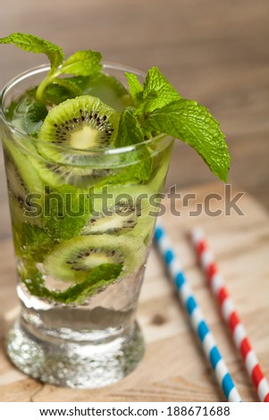 Cocktail with Mint and Kiwi in glass. Refreshing Summer Drinks. - stock photo