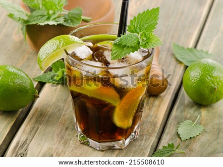 Cocktail with rum, lime, mint  and ice. Selective focus - stock photo