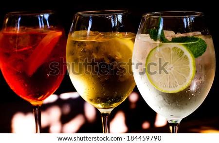 Cocktails: aperol spritz, sprizz (spriss), Martini royale. (dark background). - stock photo