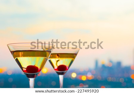 Cocktails glasses with a luxurious view - stock photo