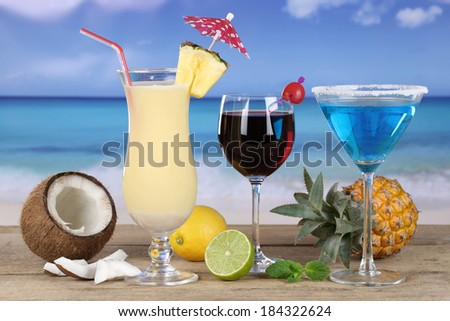 Cocktails like Pina Colada and Blue Curacao on the beach while on vacation - stock photo