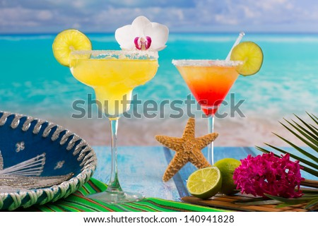 Cocktails Margarita and sex on the beach on blue Caribbean beach with Mexican hat - stock photo