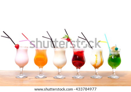 Cocktails on a white background. Various cocktails on a wooden table