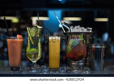 cocktails on bar background - stock photo