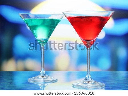 Cocktails on bright background - stock photo