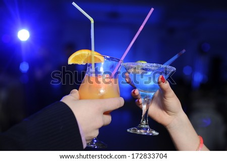 Cocktails on the neon party - stock photo