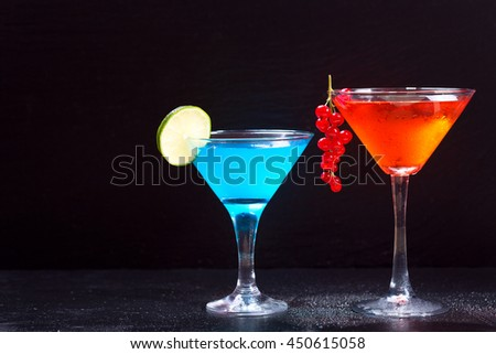 cocktails with fresh fruit on dark background - stock photo