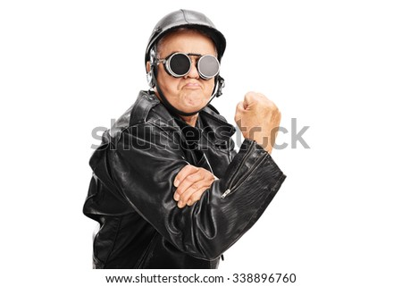 Cocky senior motorcyclist gesturing with his hand with gripped fist isolated on white background - stock photo