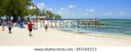 COCO CAY, BAHAMAS - MAY 26, 2015: Sandy beach with people enjoying sun and fun on a sunny day