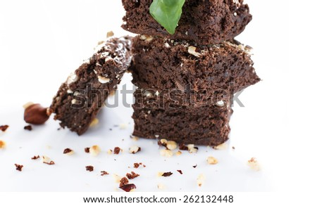 Cocoa and chocolate brownies dessert with hazelnut isolated on white background - stock photo