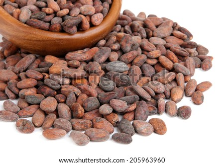 Cocoa beans in bowl, isolated on white - stock photo