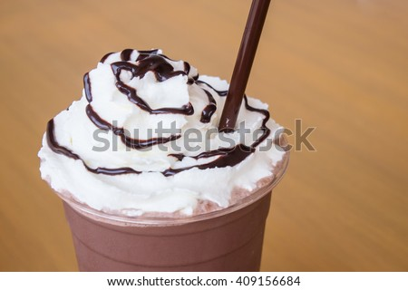 Cocoa blended with whipped cream in a glass ready to eat. - stock photo
