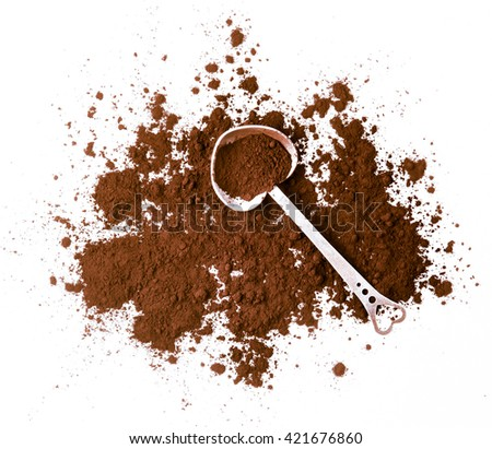 cocoa in a spoon isolated on a white background