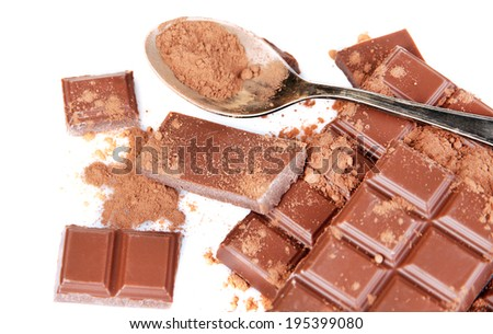 Cocoa powder and dark chocolate isolated on white