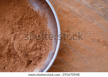 cocoa powder from above - close up of textured background - stock photo