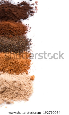 Cocoa powder, ground coffee and dried tea leaves in a white ceramic container over white background - stock photo