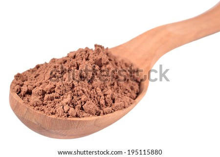 Cocoa powder in a wooden spoon on a white background - stock photo