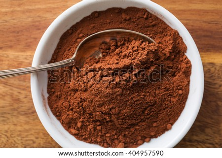cocoa powder in ceramic bowl - stock photo
