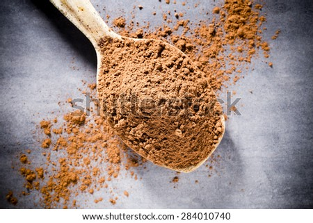 Cocoa powder on spoons. Spice, food ingredients. - stock photo