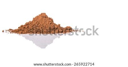 Cocoa powder over white background - stock photo