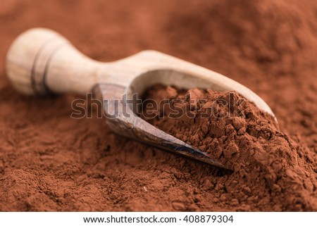 Cocoa powder (selective focus) as detailed close-up shot on wooden background - stock photo