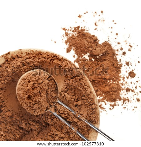 cocoa powder with scoop isolated on white background - stock photo
