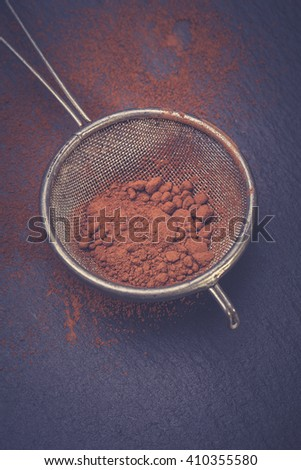 Cocoa powder with sieve - stock photo