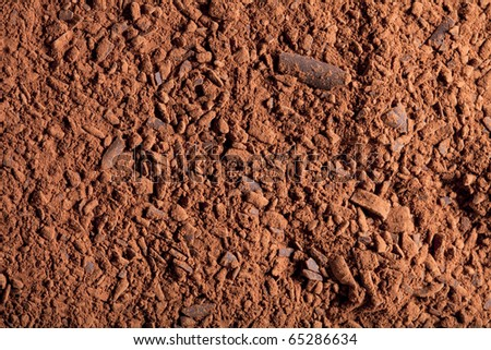 cocoa powder with small pieces of chocolate  background